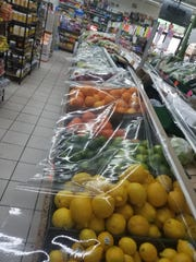 Produce covered by plastic at a Hamtramck grocery store.