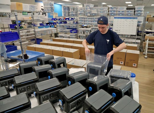 Kurt Miller prepares machines for shipment at Ventec in Bothell, Washington on Wednesday, March 18, 2020.