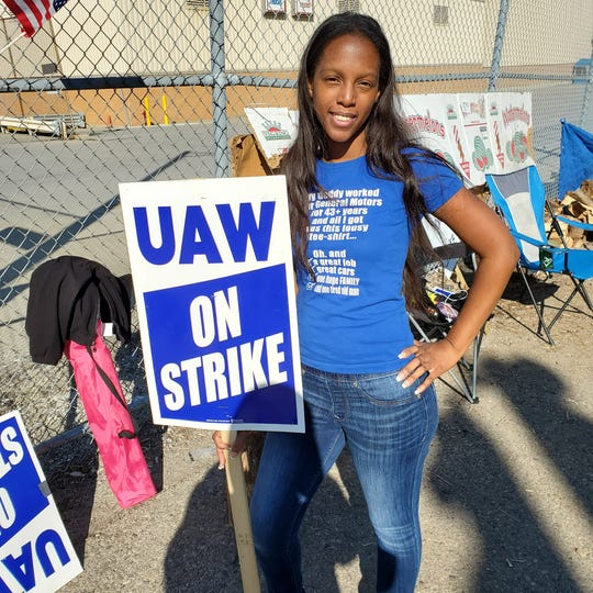 Adelphia Lyles, shown here on the picket line in October in front of Flint Assembly, just moved from a temporary job to full-time building the Chevy Silverado and GMC Sierra. She credits the UAW with having a full-time job.