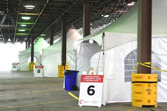 Medical tents are set up for the first day of testing at the new regional COVID-19 testing facility at the former Michigan State Fairgrounds site in Detroit on Friday, March 27, 2020.