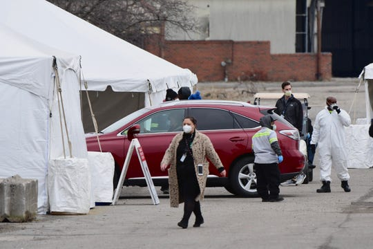 Drive-up testing for COVID-19 begins at the Michigan State Fairgrounds on Friday, March 27, 2020.