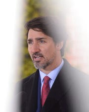 Prime Minister Justin Trudeau addresses Canadians on the COVID-19 pandemic from Rideau Cottage in Ottawa, Canada, Thursday, March 26, 2020. Trudeau has unveiled sweeping measures on Friday to protect Canada's small businesses from the economic fallout of the coronavirus