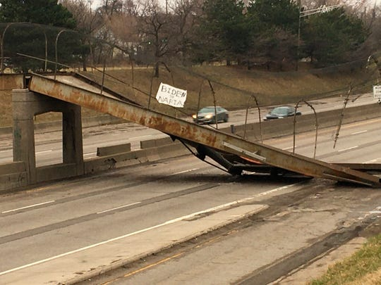 This photo provided by Michigan Department of Transportation shows the Townsend Pedestrian Bridge that collapsed onto westbound Interstate 94 early Friday, March 27, 2020 in Detroit.