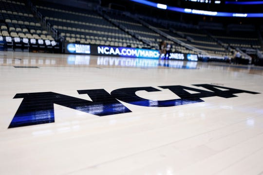 The NCAA will distribute about $225 million to its 350 member schools, down from the projected $600 million.