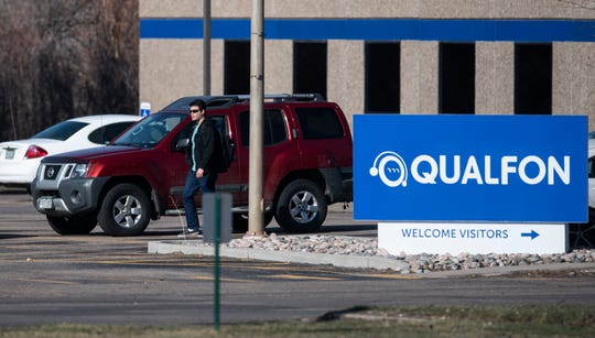 A man walks through the parking lot outside Qualfon in Fort Collins, Colo. on Thursday, March 26, 2020.
