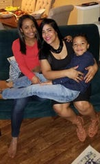 In this undated photo, Yarissa Correa, center, poses with her children at their home in Greenville.