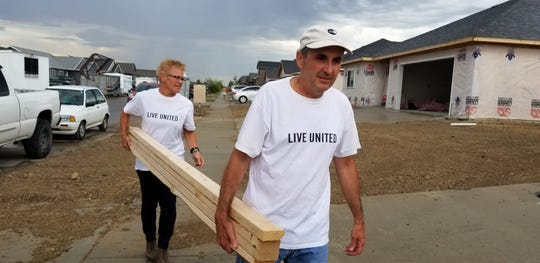 United Way of Cascade County volunteers Don Serido and Wendy Lee help out at a NeighborWorks home build. United Way has created a fund to help families in need during the coronavirus crisis.