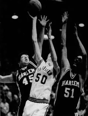 In this 1994 photo, Fairfield's Ty Thorn (50) is sandwiched betwee Harlem's Mike Main (51) and Blake Stiffarm (45) during the North-East B Divisional title game at the Four Seasons Arena.