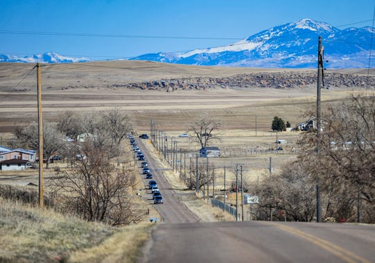 Teachers from Mountain View Elementary School parade along Gibson Flats Road on Thursday afternoon, March 26, 2020.