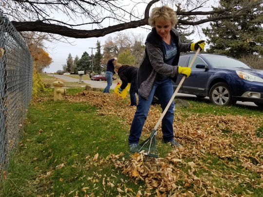 Ruth Uecker rakes leaves during United Way of Cascade County's annual Day of Caring, where volunteer teams to do yardwork for senior homeowners. United Way has set up a fund to help families during the coronavirus pandemic.