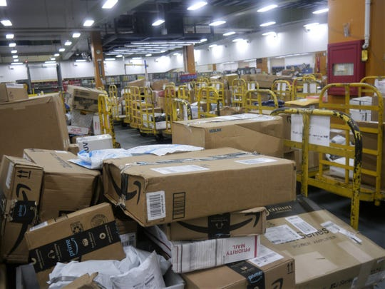 There's a huge backlog of mail cluttering the sorting bay at the U.S. Postal Service's Guam Main Facility in this March 27 photo.