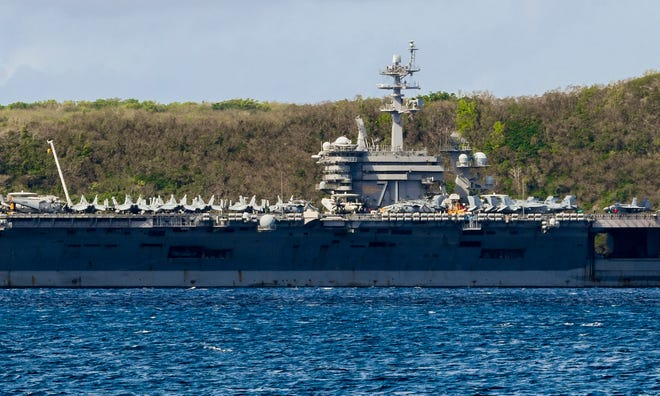 The USS Theodore Roosevelt, a Nimitz-class nuclear powered aircraft carrier, is docked in Guam as its entire crew of about 5,000 is tested for coronavirus.