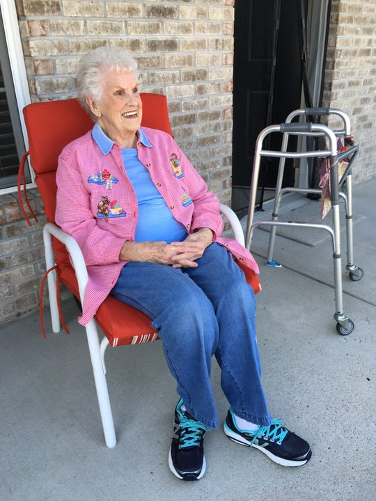 "Jeanette Burris, 89, enjoys a brief moment on her front porch as she manages staying ""healthy at home"" during the COVID-19 crisis."