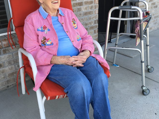 """Jeanette Burris, 89, enjoys a brief moment on her front porch as she manages staying """"healthy at home"""" during the COVID-19 crisis."""