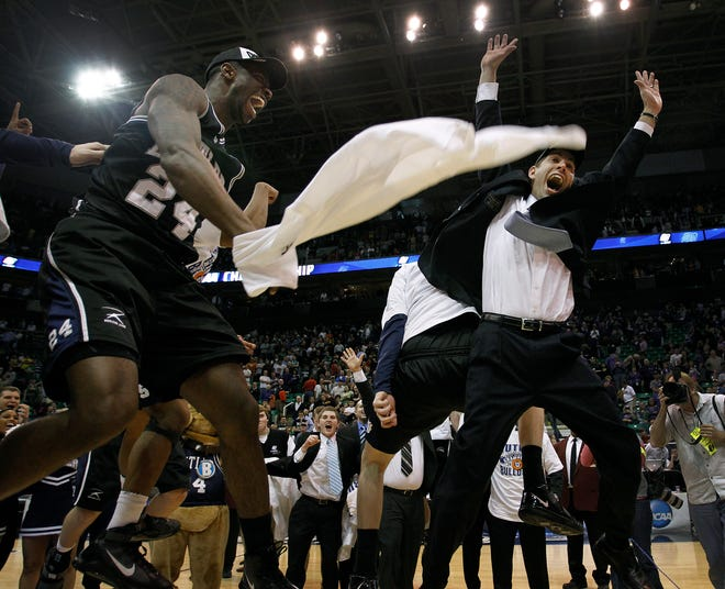 """Butler's Brad Stevens and Avery Jukes celebrate the win as Stevens """"bumps"""" Emerson Kampen at midcourt after the win. In NCAA Mens Basketball West Region Elite 8 round the #5 seed Butler mens basketball team defeated the #2 seed Kansas State mens basketball team 63-56 at Energy Solutions Arena in Salt Lake City, UT on Saturday, March 27, 2010. Butler now advances to Indianapolis to play in the Final Four."""