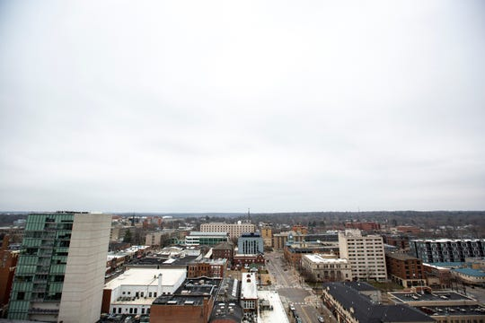A mostly desolate view looking north along Linn Street, Friday afternoon, March 27, 2020, from the 14th floor roof of Plaza Towers in Iowa City, Iowa.