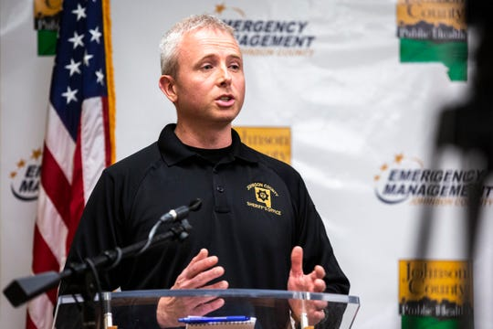 Brad Kunkel, Detective at the Johnson County Sheriff Department, answers a question during a press conference on the novel coronavirus, COVID-19, Friday, March 27, 2020, at the Johnson County Emergency Operations Center in Iowa City, Iowa.