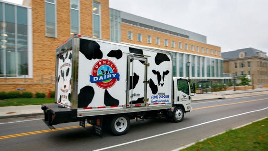 The Cornell Dairy truck passes the dairy plant in Stocking Hall along Tower Road.