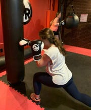 Members at 9Round go through different stations in a 30-minute process when the gym is open. There are different workouts available each day.