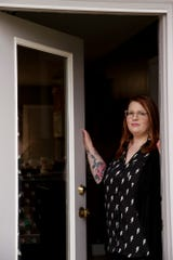Amber Glasgow poses for a photo outside her Dayton home, Thursday, March 26, 2020.