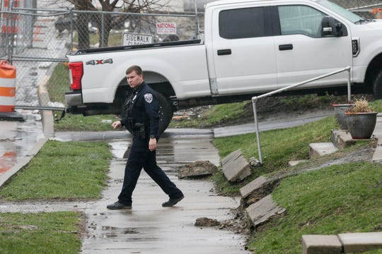 A Lafayette Police officer walks back to his cruiser after responding to a call, Thursday, March 26, 2020 in West Lafayette.