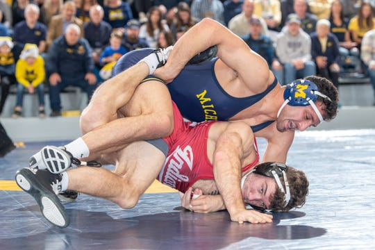 Myles Amine of Brighton plans to wrestle his final season at the University of Michigan before representing San Marino in the Summer Olympics.