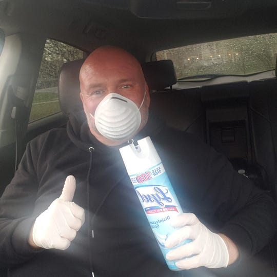 Leon Melton, 45, wears a mask as he drives Uber passengers around and sprays disinfectant on his car every time they leave.
