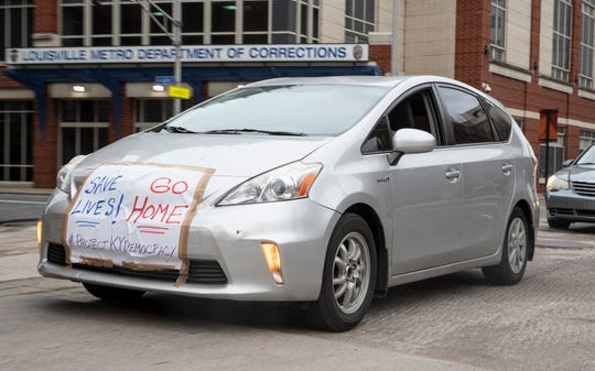 Protesters circled the Hall of Justice and Metro Corrections in downtown Louisville, Kentucky, in their cars honking their horns to seeking the release of prisoners due to the coronavirus pandemic. March 27, 2020