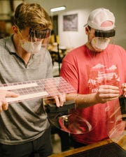 Kentuckians Clay Simpson (left) and dentist Dr. Tyler Jury (right) came up with a face shield to protect against COVID-19. (Photo courtesy of Tyler Jury)