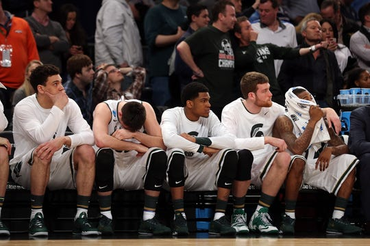 The Michigan State Spartans bench looks on late in the game against the Connecticut Huskies during the East Regional Final of the 2014 NCAA Men's Basketball Tournament at Madison Square Garden on March 30, 2014 in New York City.