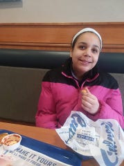 Isabella Brooks of Manitowoc eats at Culver's after recovering from brain cancer surgery and returning home.