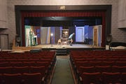Mansfield Playhouse artistic director Doug Wertz moves saw horses Friday afternoon as the stage set building has come to a halt due to COVID-19.