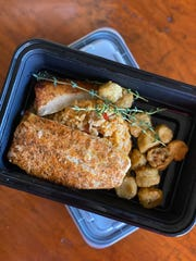 A takeout order of Blackened Louisiana Redfish from Coastal Fish Company.
