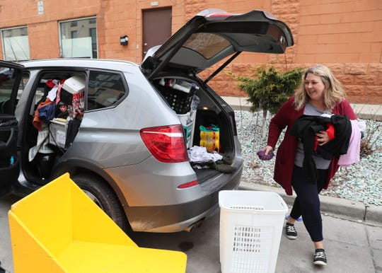 March 27 2020, Jenny Pierre of Seymour helped move her daughter Macy Patza's belongings out of the UW-Milwaukee Cambridge Commons dormitory. UWM is staggering the move dates for each dormitory.