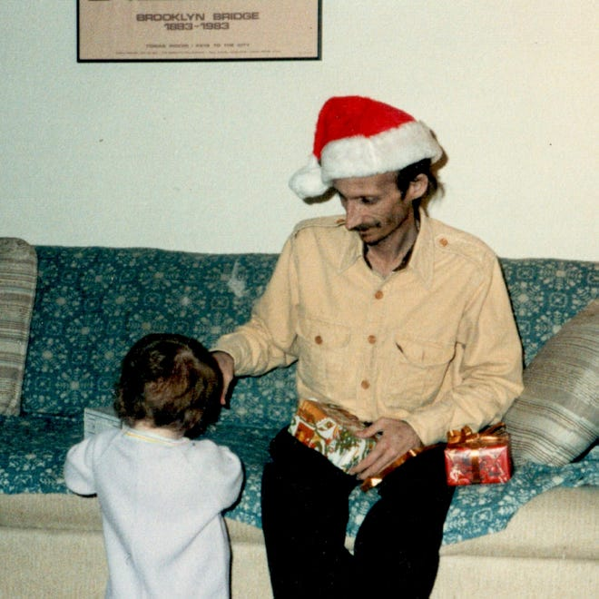 David Le Grand during Christmas 1987 with his youngest daughter, Mahalia: This is one of the last pictures of David before he died in February 1988.