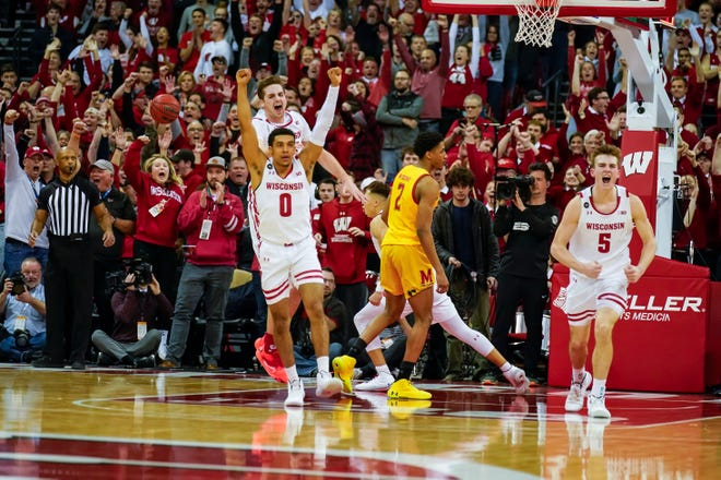 UW players start celebrating their tense 56-54 victory over Maryland on Jan. 14 at the Kohl Center. The victory eventually enable the Badgers to grab a share of the Big Ten title.