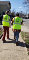 Mutual Morris founder Theresa Markila and Wind of the Spirit co-founder Diana Mejia walk the streets of Dover while handing out information on the coronavirus outbreak and resources.