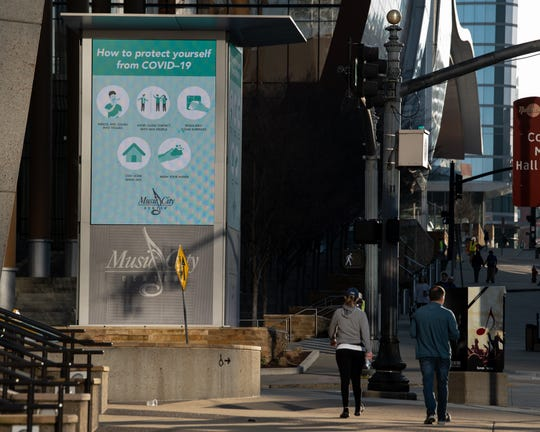 A sign outside of Music City Center explains COVID-19 precautions in downtown Nashville, Tenn., Wednesday, March 25, 2020. Downtown Nashville was eerily slow on Wednesday afternoon as the coronavirus outbreak continued to force many people indoors.