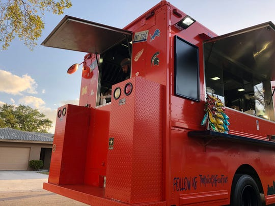 Motor City food truck serves to-go meals in Victoria Park in North Naples on Thursday, March 19, 2020.