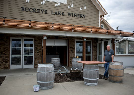 Tracy Higginbotham stands in front of Buckeye Lake Winery. Their kitchen is still open for takeout but business has slowed due to the coronavirus.