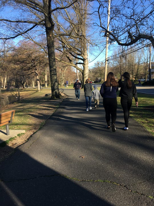 People walking on the path at Saddle River County Park in Ridgewood on Friday, Match 27, 2020.