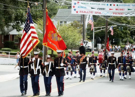 The Marine Corps color guard leads a parade north on High Mountain Road to kick off festivities of North Haledon Day.