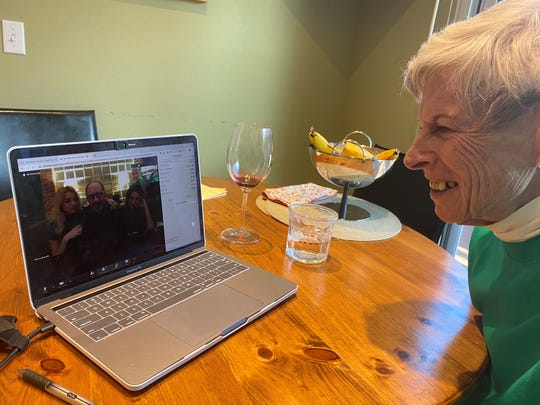 Nancy Farley gets together with her family for a virtual wake on her laptop to mark the death of Mike Farley, her husband of 59 years. Mike Farley, 87, died in a Denver hospital on March 23, 2020, with family not permitted to be at his side. The coronavirus outbreak is changing how we grieve, including the way funerals are handled.