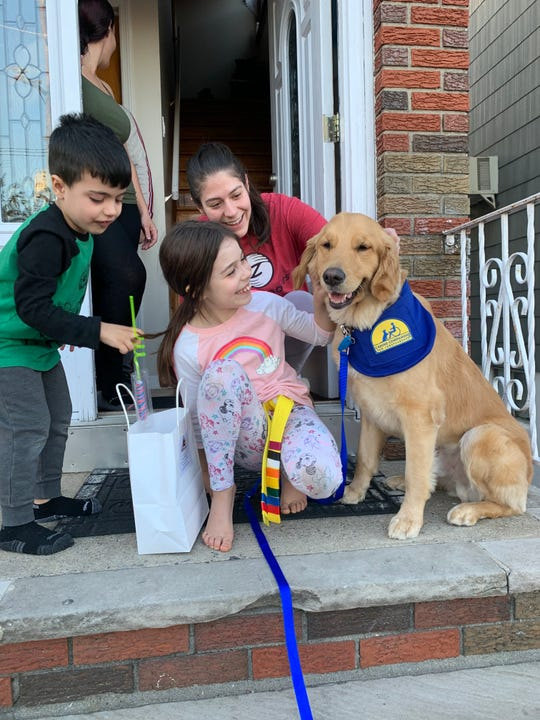 Allen DePeña, owner and instructor at Zentai Martial Arts in North Arlington, and service dog, Ladd III, have gone around to students at their school and dropped off bags filled with things to help keep them occupied.