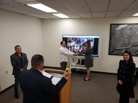 Genaro and Diana Delgado during their wedding ceremony Friday at Passaic City Hall. The couple have known each other for 10 years and decided to tie knot. Also in picture are witnesses Arturo Ortega and Lilia Rios and in foreground Passaic Mayor Hector Lora who performed the ceremony.