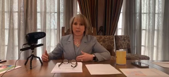 New Mexico Gov. Michelle Lujan Grisham gives a livestreamed address on Friday, March 27, 2020.