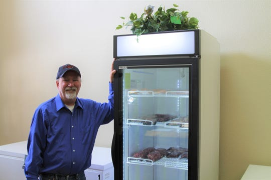 Jon Schuster, owner of Meat on the Mountain, opened for business selling quality meat products at the Burro Exchange in the Village of Cloudcroft on Thursday.