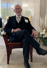 Stephen Schullo relaxes — six feet away from others — on his wedding day.