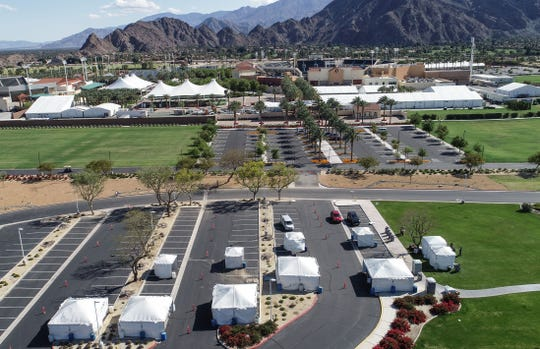 Tents in the parking lot of Southwest Church (foreground) serve as a drive-thru testing site for the coronavirus in Indian Wells, March 25, 2020.  The emtpy Indian Wells Tennis Garden can be seen in the background and would normally be hosting the BNP Paribas Open this time of year.