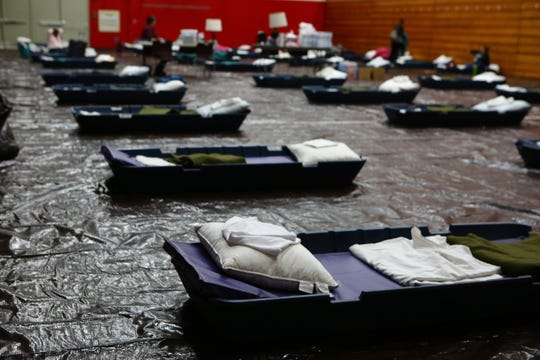 Bedding is set up inside the emergency overnight shelter in Palm Springs, Calif., on Thursday, March 26, 2020. The shelter has temporarily been moved to the Palm Springs High School gym to practice social distancing and minimize the spread of coronavirus.